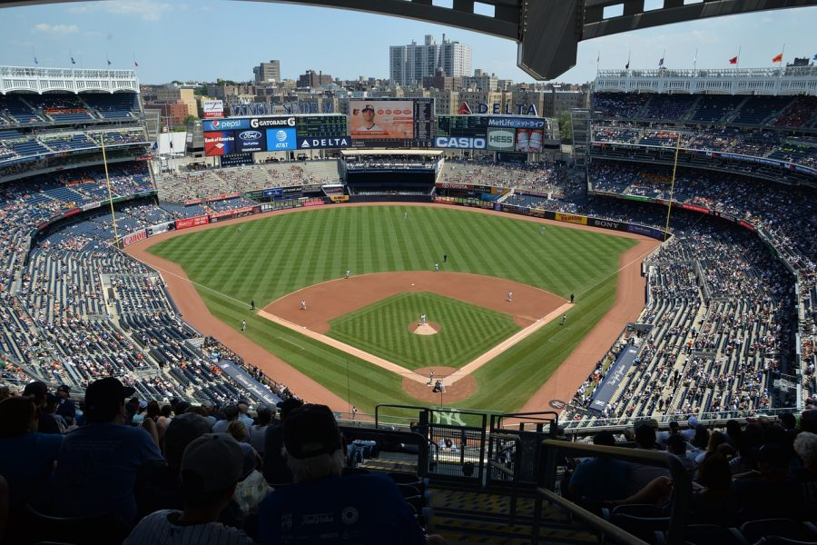 With+the+Major+League+Baseball+regular+season+coming+to+an+end%2C+it+is+time+to+look+ahead+to+what+the+playoffs+will+have+in+store+for+New+York+Yankees+fans.Throughout+the+entire+2019+season%2C+there+have+been+major+questions+of+who+will+make+the+postseason+roster+due+to+the+constant+injury+bug+and+the+%E2%80%9Cnext+man+up%E2%80%9D+mentality.The+Yankees%E2%80%99+season+was+defined+by+the+resilience+of+the+young+players+that+took+over+for+veterans+and+their+ability+to+continue+to+dominate+not+only+the+American+League+East%2C+but+the+entire+MLB.The+hard+part+comes+in+predicting+what+the+25-man+playoff+roster+will+be.There+are+those+few+players+that+have+been+key+contributors+to+the+team%E2%80%99s+success+that+will+not+be+making+the+roster.This+will%2C+of+course%2C+upset+fans+and+will+cause+some+scrutiny+of+the+front+office+and+management.It+will+be+interesting+to+see+which+players+will+make+the+competitive+25-man+playoff+roster+and+compete+towards+the+Yankees%E2%80%99+potential+28th+World+Series+championship.Catchers%3A+Gary+Sanchez%2C+Austin+RomineThis+is+one+of+the+easiest+positions+to+predict.Once+Sanchez+is+healthy+from+the+nagging+groin+injury+that+he+has+dealt+with+for+the+better+part+of+the+last+two+seasons%2C+he+is+the+number+one+catcher+and+a+middle-of-the-order+guy.His+greatly+improved+defense+and+the+combination+of+his+quickness+and+strong+arm+to+throw+out+runners+on+stolen+base+attempts+is+a+huge+asset+for+the+Yankees.Romine+has+been+an+excellent+backup+and+has+shown+his+worth+to+the+team+during+Sanchez%E2%80%99s+injury.+If+needed%2C+he+will+be+able+to+slide+into+the+bottom+of+the+order+and+present+great+defensive+skills.This+also+gives+Sanchez+a+day+off+and+the+possibility+for+him+to+pinch+hit.Infield%3A+Luke+Voit%2C+Edwin+Encarnacion%2C+DJ+LeMahieu%2C+Gleyber+Torres%2C+Didi+Gregorius%2C+Gio+Urshela%2C+Tyler+WadeThis+group+of+players+will+be+interesting+to+keep+an+eye+on.Here%2C+the+odd+man+out+is+Urshela%2C+which+may+come+as+a+huge+shock+to+many%2C+but+h